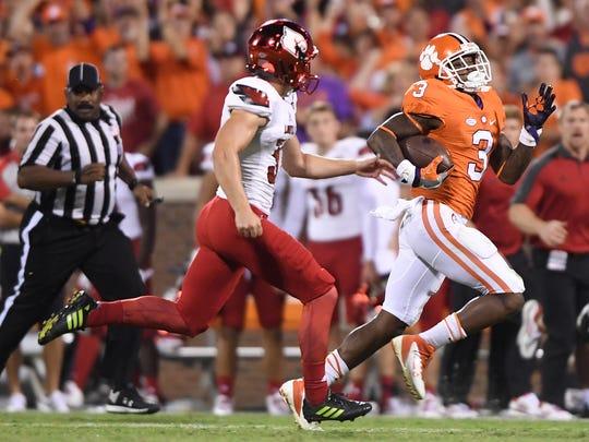 Clemson wide receiver Artavis Scott (3) returns a kickoff 77 yards against Louisville during the fourth quarter on Oct. 1 at Clemson's Memorial Stadium.