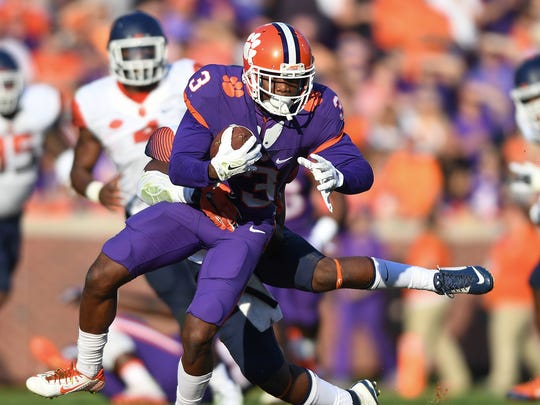 Clemson wide receiver Artavis Scott (3) makes a reception