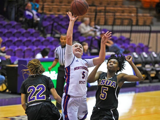 NSU guard Sami Thomas (5) lays it up against LSUA.