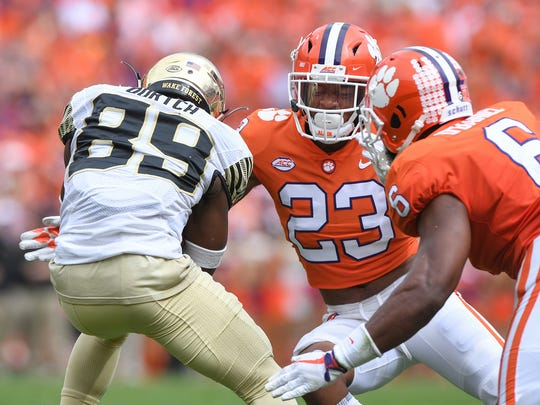 Clemson defensive back Van Smith (23) tries to stop Wake Forest wide receiver Greg Dortch (89) during the 2nd quarter on Saturday, October 7, 2017 at Clemson's Memorial Stadium.
