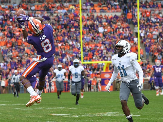Clemson wide receiver Deon Cain (8) catches a pass past The Citadel defensive back Ben Roberts (11) to score on a 51 yard pass and carry during the 1st quarter on Saturday, November 18, 2017 at Clemson's Memorial Stadium.
