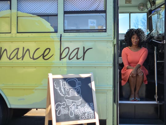 Financial trainer, her financial literacy bus are on the move in Charlotte