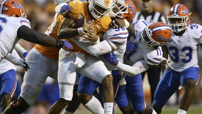 Tennessee quarterback Jarrett Guarantano is tackled by Florida players during the first quarter of their Sept. 2018 game in Knoxville, Tenn.