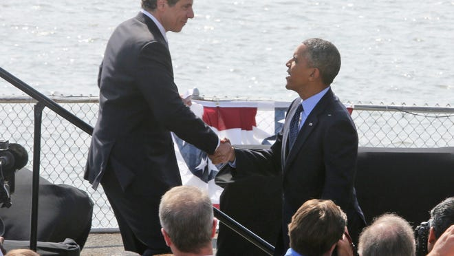 President Barack Obama is greeted by New York State Governor Andrew Cuomo as he arrives at the Washington Irving Boat Club in Tarrytown Wednesday. The President spoke about the need for Congress to fund road and bridge improvements across the nation.