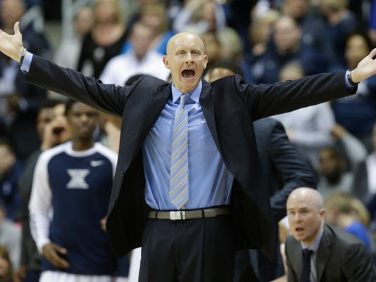 FILE - In this March 5, 2016, file photo, Xavier head coach Chris Mack reacts to a call during the first half of an NCAA college basketball game against Creighton, in Cincinnati. Fifth-ranked Xavier completed one of the best regular seasons in its history, tying the school record with 26 wins. Now comes the time when the Musketeers can set themselves apart. (AP Photo/John Minchillo, File)