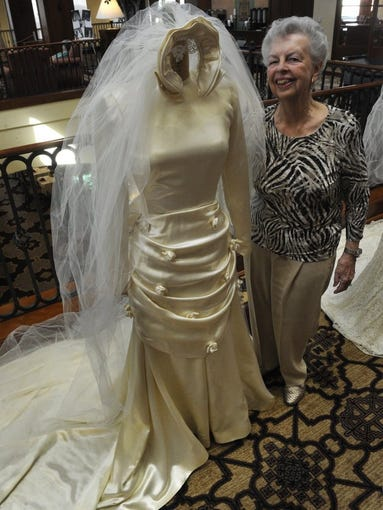 """CHUCK KIRMAN/THE STAR Marcia Fogel with her 1949 wedding dress. From 11 a.m. to 2 p.m. on Sunday, February 14, University Village Thousand Oaks will present """"The Way We Were.""""Wedding gowns from 1899 to 1972, that were worn by residents will be on display in Mount Clef Terrace and will be open to the public."""