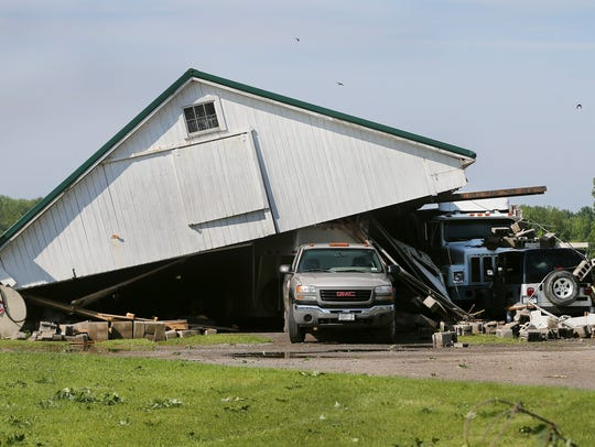 A barn roof was blown onto several vehicles at Gerlock