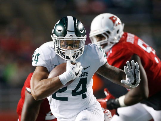 Gerald Holmes rushes against Rutgers in the season finale on Nov. 25.