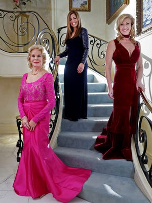 From left, Sandra Mills, of Menasha, Camille Solberg, of New London, and Kristine Newhouse, of Neenah, stand in the gowns they will be wearing to various events for the 2017 United States Presidential Inauguration in Washington D.C. Wednesday, Jan. 11, 2017, in Menasha, Wis. This will be Mills' third trip to a presidential inauguration, Holberg's second, and Newhouse's first.