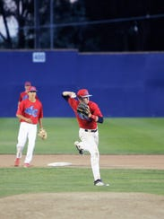 4-C shortstop Cody McGaha fields the ball and throws