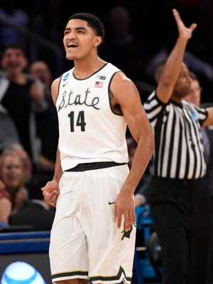 Michigan State guard Gary Harris (14) reacts to a shot during the first half against Connecticut in the NCAA tournament.