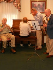 The Rhythm Kids, made up of Ted Peters ('39), Jeanne Wishard Locke ('41), and Harold Angle ('41), entertain members of the Chambersburg High School Class of 1941 during their 75th reunion.