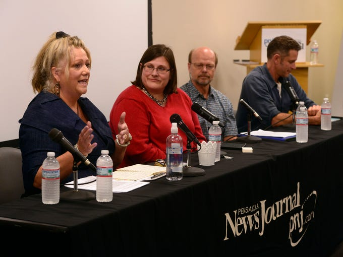 A panel of speakers take questions during a forum hosted