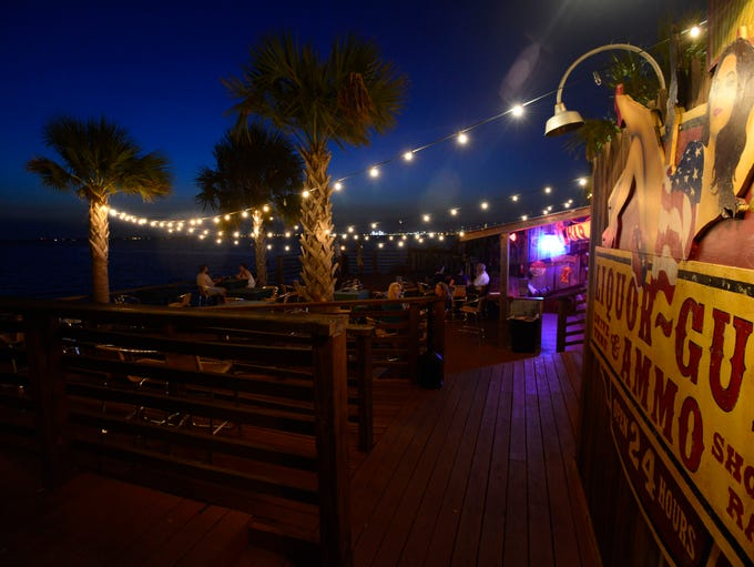 A crowd gathers at The Bridge Bar in Gulf Breeze on