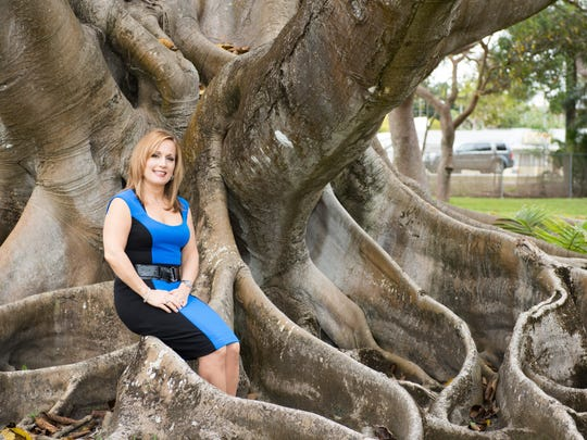 Dr. Teresa Ann Sievers poses  at Shangri-La in Bonita Springs during a photo shoot for the May cover story for eBella Magazine.