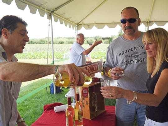 Yankee Folly Cidery Cider Master, Edmund Tomaselli pours a sample for Lori and Mike DeRosa of Beekman during the Hudson Valley Cider Festival