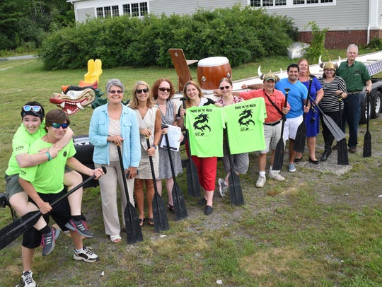 Members of Dutchess Tourism join the crews of dragon