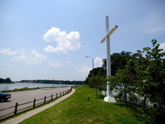 A Washington, D.C., advocacy group is calling for the removal of the large cross at Bayview Park