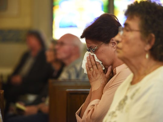 Baguslawa Lisle, center, of the City of Poughkeepsie, listens to the final mass at St. Joseph's Church. Originally from Poland, she has been going to this church for 8 years.