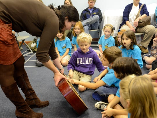 Megan Hearne, director of education at The Colburn Earth Science Museum, teaches second grade students from the Bryson City Mountain Discovery Charter School about sound on Wednesday, September 30, 2015. Students pluck guitar strings learning about the relationship between pitch and frequency.