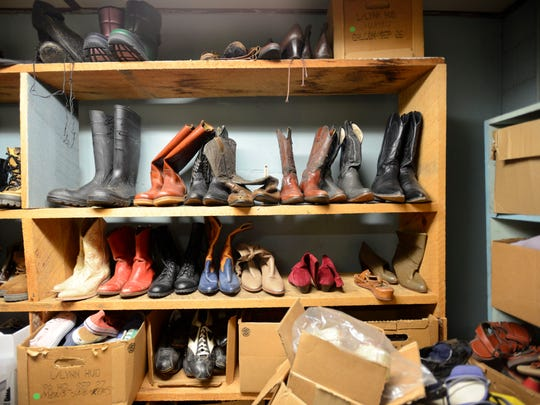 Shoes line shelves and are piled high in boxes in the Asheville Community Theater Costume Shop on Friday, October 2, 2015.