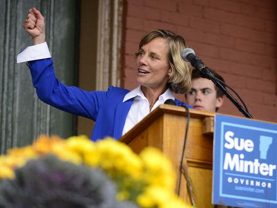 "Democratic gubernatorial candidate Sue Minter raises a ""torch"" for former Gov. Madeleine Kunin, Vermont's first female governor, at a campaign kickoff Tuesday in Waterbury."