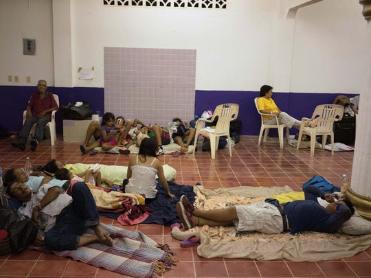 "People wait for the arrival of Hurricane Patricia inside a shelter in the Pacific resort city of Puerto Vallarta, Mexico, Friday, Oct. 23, 2015. Hurricane Patricia barreled toward southwestern Mexico Friday as a monster Category 5 storm, the strongest ever in the Western Hemisphere. Residents and tourists hunkered down or tried to make last-minute escapes ahead of what forecasters called a ""potentially catastrophic landfall."" (AP Photo/Cesar Rodriguez)"