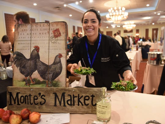 Dafna Mizrahi serves green salads from Monte's Local Kitchen and Tap Room in Amenia.