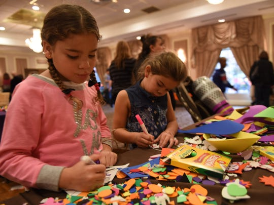 Angelina Rodriguez, 11, of Ellenville and Shannon Evans, 6, of Poughkeepsie make crafts during Vassar Brothers Medical Center's Neonatal Intensive Care Unit reunion Sunday at the Poughkeepsie Grand Hotel.