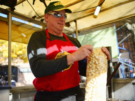 Paul Buschner of A-Maize-ing Kettle Corn prepares his first batch of the day on Nov. 7.