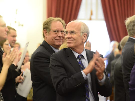 """Mark Snelling, left, and U.S. Rep. Peter Welch, D-Vt., stand Friday for """"one more round of applause"""" for former Gov. Richard Snelling and former Lt. Gov. Barbara Snelling at a memorial service for Barbara Snelling in the House Chamber in Montpelier."""