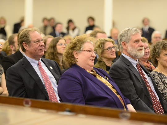 Members of the Snelling family listen Friday during