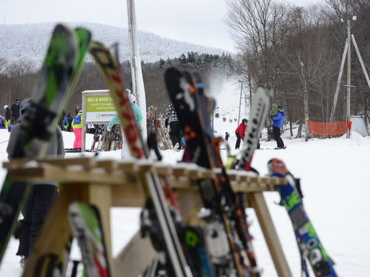 Skis and snowboards line the racks at Bolton Valley Resort on Jan. 2, 2016.