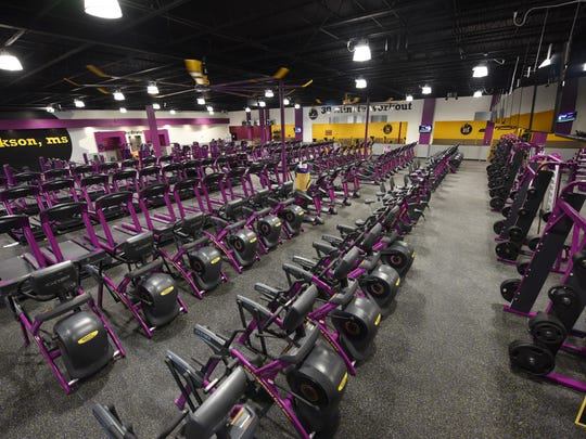 Rows of exercise machines await customers at Planet FItness's newest area location in Deville Plaza in Jackson.