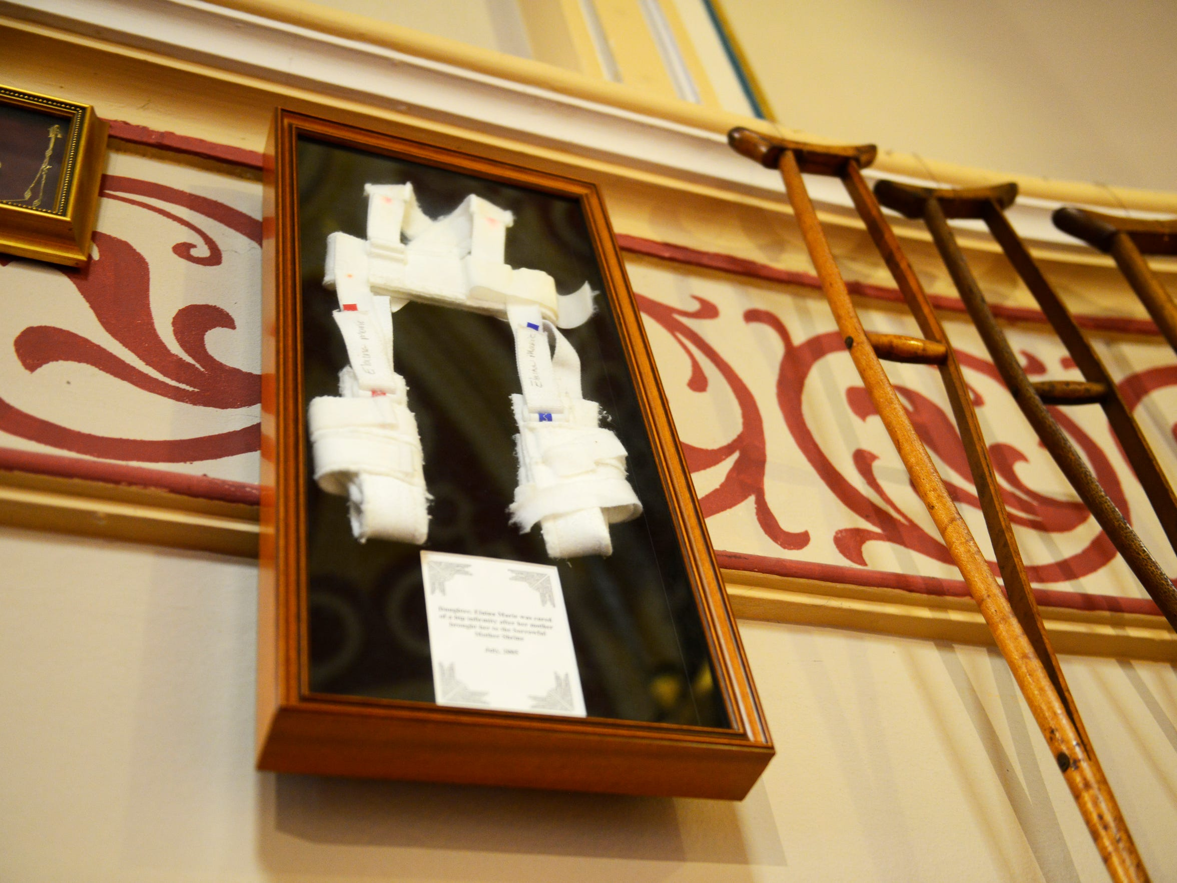One of many miracles attributed to the Sorrowful Mother Shrine, a young girl's bandage hangs on the wall, left after she prayed to the Sorrowful Mother, was healed and became able to walk.