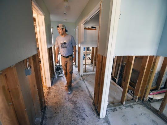 Matthew Hendry walks through the Farmerville home of