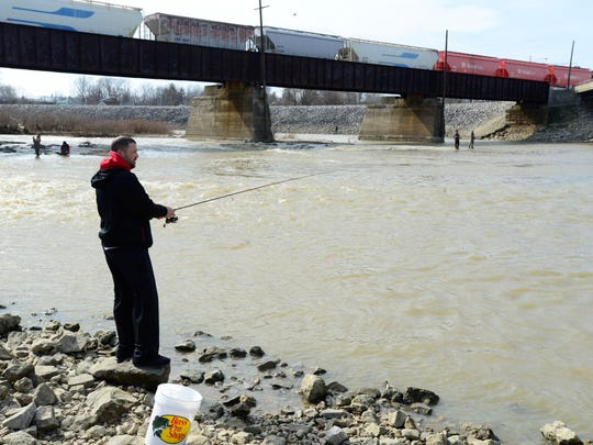 Fred Jones of Tiffin fishes for walleye in the Sandusky River in Fremont on Tuesday afternoon.