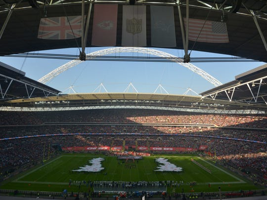 General view of the playing of the British and the United States national anthems before an NFL game at Wembley Stadium.