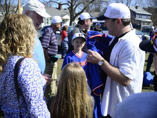 Assistant coach Tom Simon, right, and son Nolan Simon, 12, center, present Sen. Patrick Leahy with a team jersey on Sunday at Callahan Park. The team is heading to Cuba from Sunday until April 23.