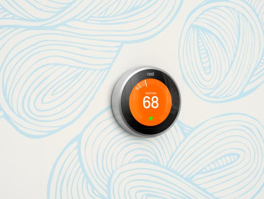 Nest smart thermostat.
