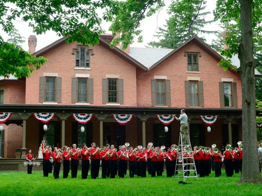 The Ohio State University Marching Band performs at the centennial celebration at the Hayes Presidential Center on Saturday.