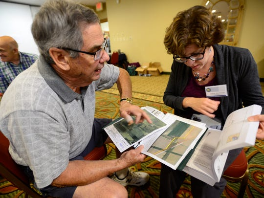 Edmund Miller, left, talks to Joanne Wachholder with the Federal Energy Regulatory Commission about his concerns with the proposed NEXUS pipeline that would go through his Luckey Road property, a family farm for 200 years.