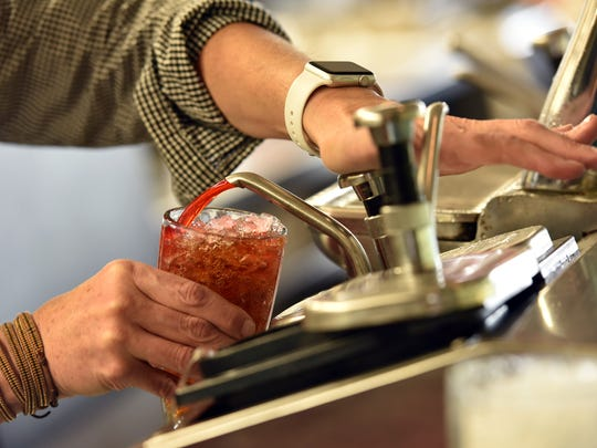 An employee makes a cherry Coke at Brent's Drugs on Friday. The Fondren diner is in its 70th year of operation.