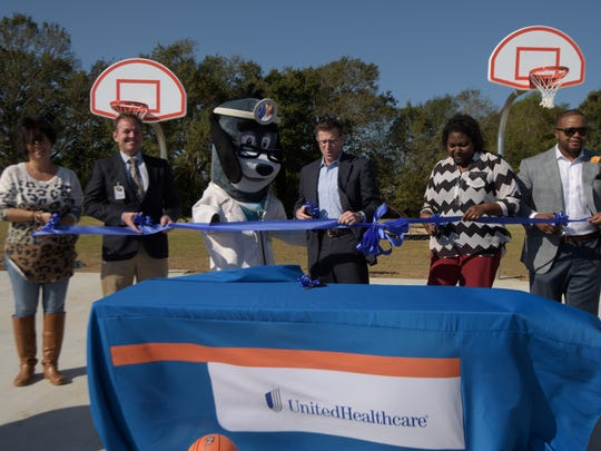 "Vermilion Parish Superintendent Jerome Puyau, UnitedHealthcare Mascot Dr. Health E. Hound, UnitedHealthcare-Gulf States CEO Joe Ochipinti, James A. Herod Elementary Principal Lysonia Robertson and Dreambuilders Foundation ""Captain,"" and former LSU MVP Justin Vincent join together to dedicate the new outdoor basketball court, made possible through UnitedHealthcare's 10,000 donation."