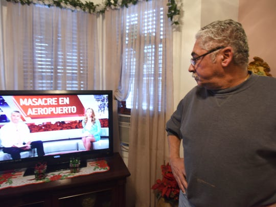 Hernan Rivera, uncle of 26-year-old Esteban Santiago, the Florida shooting suspect, watching news at his apartment in Union City  Viorel Florescu/NorthJersey.com