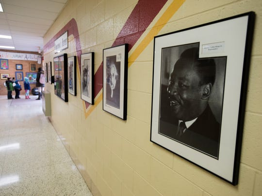 A portrait of Martin Luther King Jr. hangs in the hallway Monday, Jan. 16, at Michigamme Elementary School.