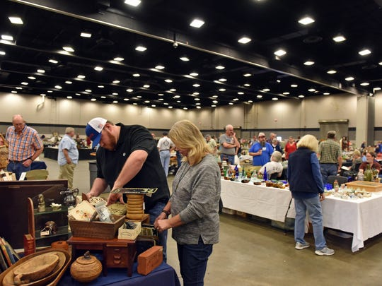 Antique bottle enthusiasts attend the 31st annual Antique Bottle Show at the Trade Mart in Jackson Saturday. A new facility would give vendors more space for such shows, plus a state-of-the-art kitchen and increased parking.