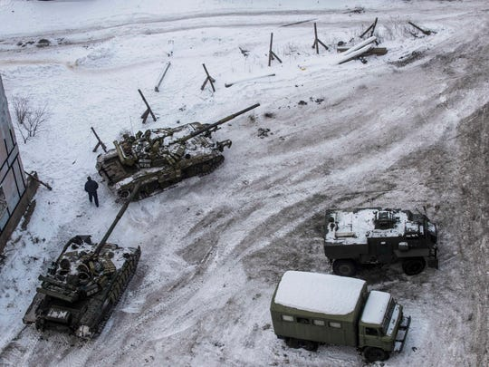 Ukrainian tanks stand in the yard of an apartment block in Avdiivka, eastern Ukraine, Wednesday, Feb. 1, 2017. Heavy fighting around government-held Avdiivka, just north of the rebel-stronghold city of Donetsk, began over the weekend and persisted into early Wednesday. The Contact Group called for the opposing sides to cease fire and urged them to pull back their heavy weapons by the end of the week. (AP Photo/Evgeniy Maloletka) ORG XMIT: MOSB136