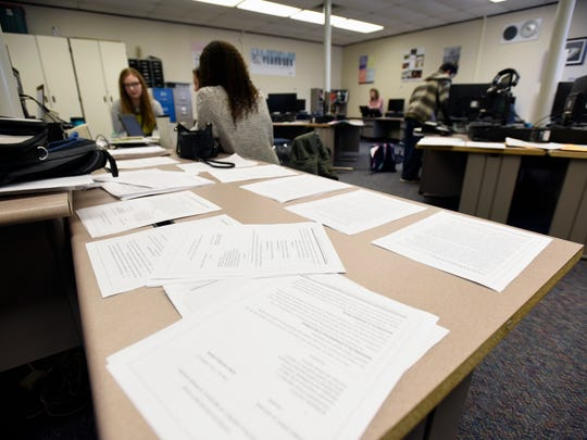 Legal practice paperwork fills a table Monday, Feb. 20, during mock trial practice at Capac High School.