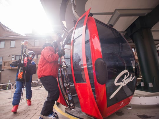 Skiers load onto gondola at Stowe Mountain Resort on Tuesday, Feb. 21, 2017. Vail Resorts announced Tuesday it was buying Stowe for $50 million.